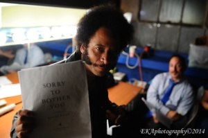 Boots Riley holds up a copy of his screenplay
