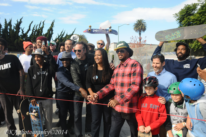 K-Dub (center) cuts the ribbon at Town Park
