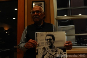 Henry Raulston with a photo of Stokely Carmichael.
