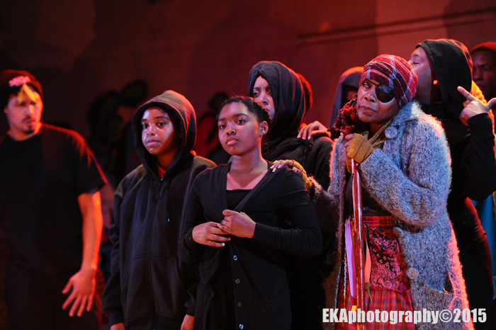 """The """"Greek chorus"""" raps, sings, and offers social commentary"""