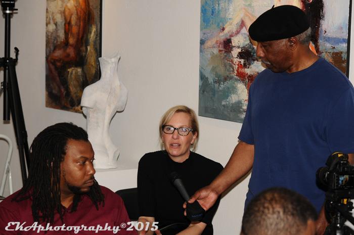 Juan Davis (l.) looks on as Kelly Amis (r.) is interviewed