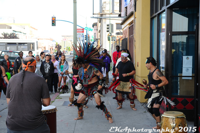 Aztec dancers outside La Cultura Cura Cafe