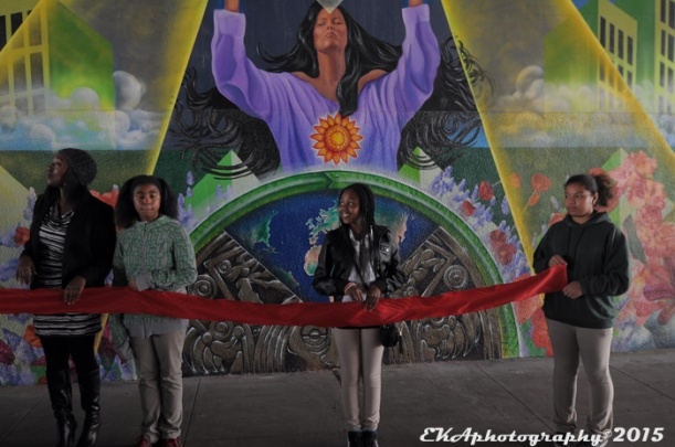 Attitudinal Healing connection's Amana Harris (l.) and youth perpare to cut the ribbon on AHC's