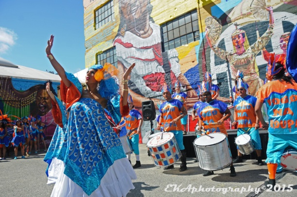 Fougo Na Roupa dance in front of a CRP mural honoring Brazilian samba legend Jose Lorenzo
