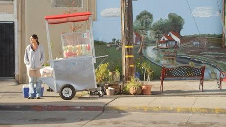Juana (Diana Elizabeth Torres) works at a Fruitvale fruit cart. Photo courtesy Anthony Lucero